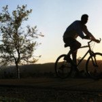 bicyclist at sunset