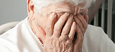 distraught woman in nursing home