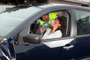 Sunrise car accident attorney - injured woman in car crash