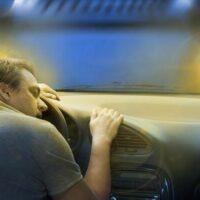 man sleeping on the car