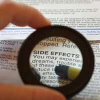 """magnifying glass on the word """"side effects"""""""